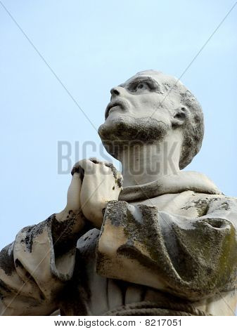 Statue Of A Praying Monk