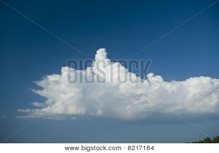 White Cloud In Dark Blue Sky