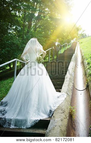 Bride standing on a staircase.