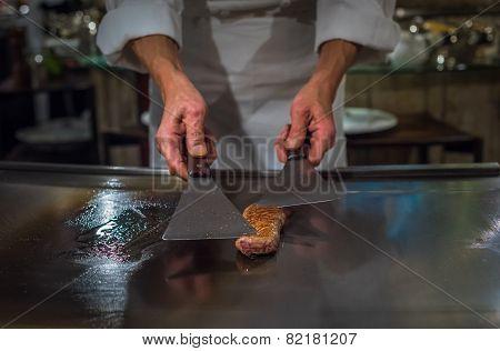 Chef Cooking Wagyu Beef In Japanese Teppanyaki Restaurant, Tokyo, Very Shallow Focus