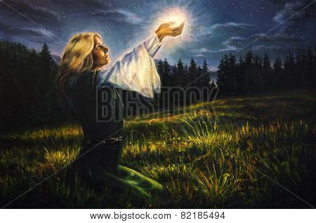 Beautiful Mystical Young Woman In Green Emerald Medieval Dress Is Holding A Glowing Ball Of Light In