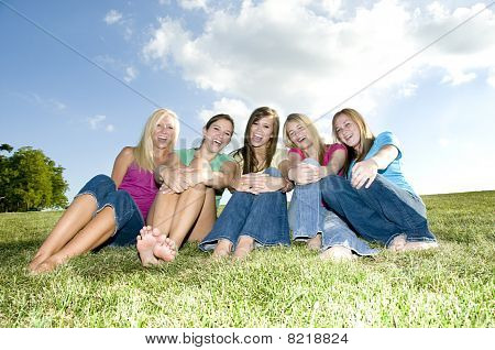 5 Girls Sitting Together And Laughing