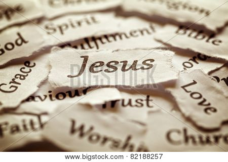 Torn paper words of religion with focus on word Jesus poster