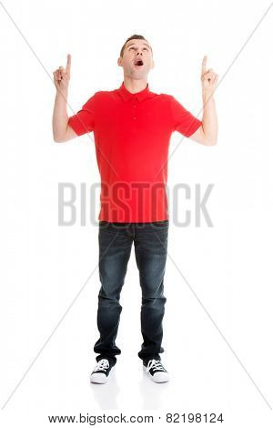 Excited man pointing on copy space