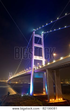 Night scene of Tsing Ma Bridge with illuminated light in Hong Kong, Asia.