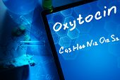 Tablet with the chemical formula of Oxytocin. Test tubes, tablets and chemical formulas. poster