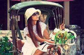Young White Woman Sitting In Rickshaw And Looking Away