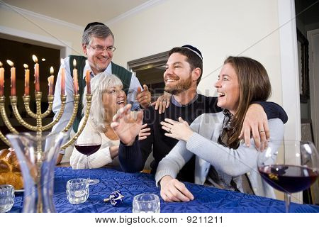 Jewish Family Celebrating Chanukah