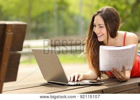 Student Learning With A Laptop In An University Campus