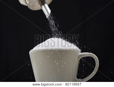 Man Hand With Sugar Bowl Pouring A Crazy Lot In Full Coffee Cup In Addiction Concept