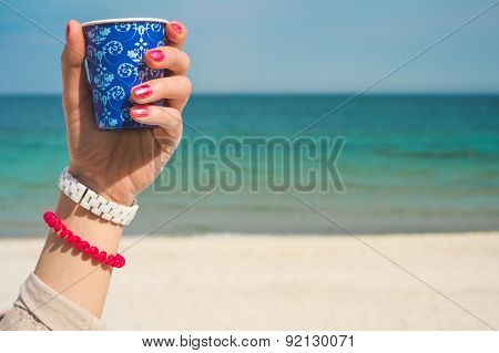 Blue Cup Of Coffee With An Ornament