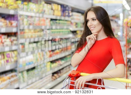 Happy Woman Shopping  at The Supermarket