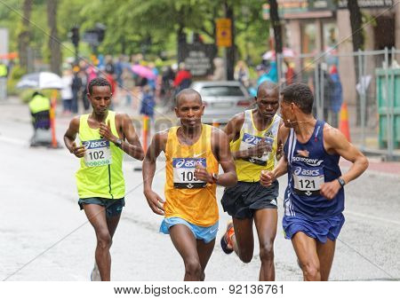 Four Male Runners In The Lead