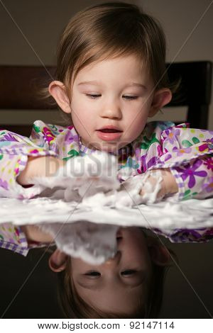Creative Toddler Playing With White Foam