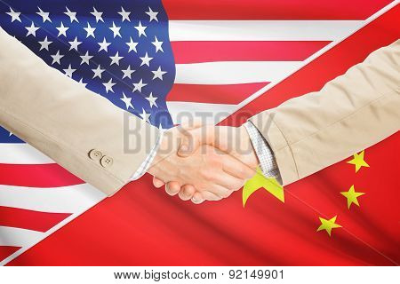 Businessmen shaking hands - United States and China poster