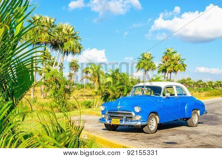 Blue classic American car on Cuba