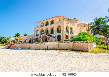 Sandy beach in Varadero with amazing old villa