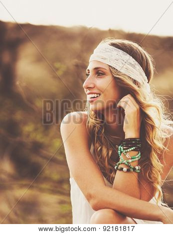 Fashion Lifestyle, Portrait of Beautiful Young Woman Backlit at Sunset Outdoors. Soft warm colors.