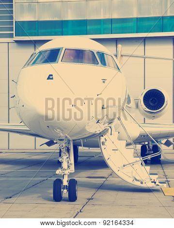 Luxury Business Private Jet plane at airfield toned in blue poster
