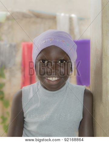 African girl wearing a cotton cap, ten years old