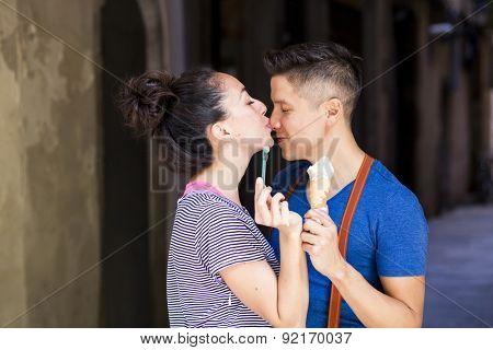 Young romantic couple sharing an ice cream. El Born, Barcelona