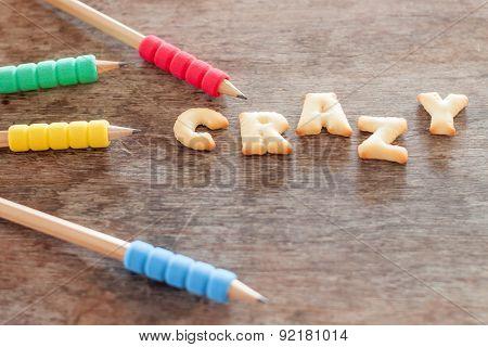 Crazy Alphabet Biscuit On Wooden Table