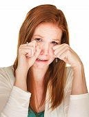 Isolated beautiful sobbing female rubbing her eyes poster