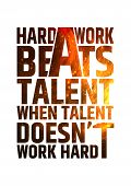 Hard work beats talent when talent doesn't work hard. Motivational inspiring quote on colorful bright fire background. Vector typographic concept poster