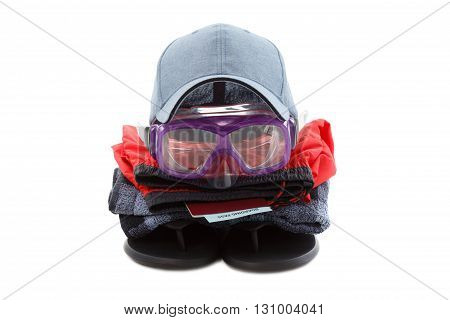 Concept of clothing and diver goggles, preparing for rest, isolated on white background