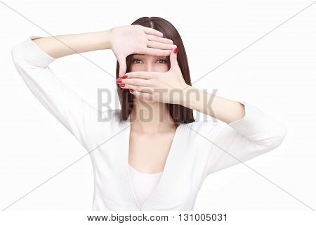 young woman imagine shooting isolated on white background