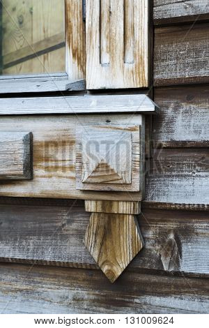 The corner of the old wooden Windows in historic part of Moscow Park Kolomenskoe. Russia.