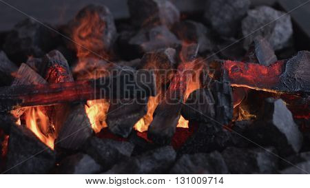 Fireplace burning. Warm cozy burning fire in a brick fireplace close up. Cozy background