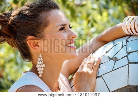 Portrait Of Happy Young Woman In Park Guell, Spain