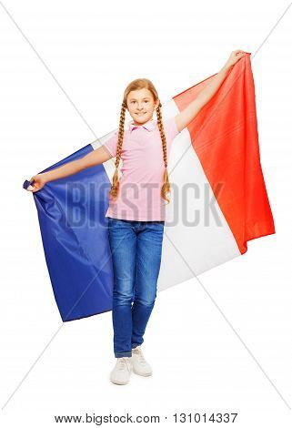 Smiling teenage girl with two long plaits holding unfolded French flag behind her back, isolated on white