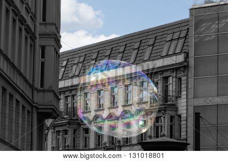 real estate bubble concept - soap bubble and building facade