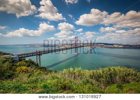 The 25 de Abril Bridge is a bridge connecting the city of Lisbon to the municipality of Almada on the left bank of the Tejo river Lisbon