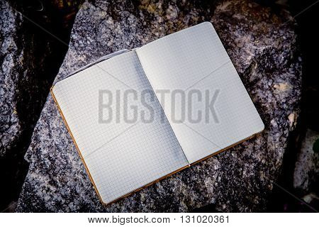 Entries In A Notebook, Net Notebook On A Granite Stone
