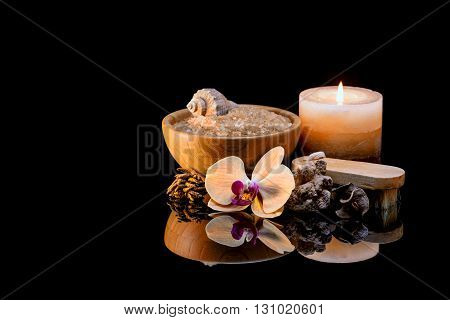 Spa still life with aromatic candles on black background