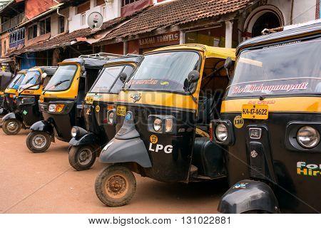 Gokarna, India - January 19, 2016: Tuk-tuks or motor rikshaw waiting for pasangers in Gokarna, Karnataka, India
