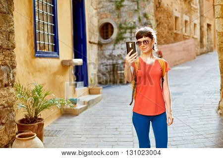 woman tourist walking in the old town, Crete, Greece