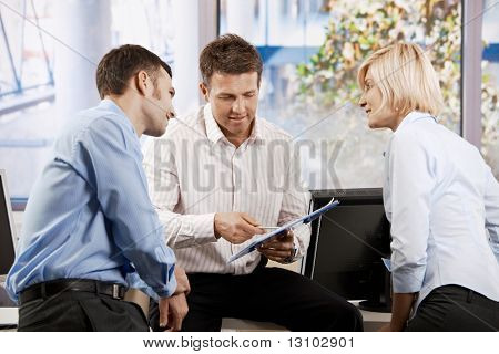 Business team working in office, people talking smiling.