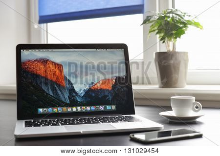 Kiev Ukraine - May 15 2016:Brand new Macbook Pro with with Retina display and OS X EL Capitan on table. MacBook is a brand of notebook computers manufactured by Apple Inc.