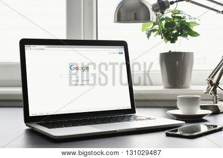 Macbook Pro With Google App On Screen
