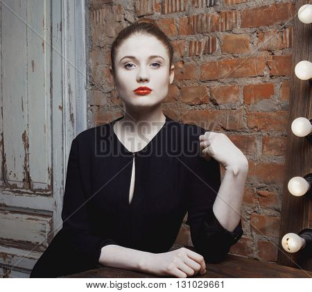 young stylish woman in make up room with mirror, diva actress before perfomance red lips