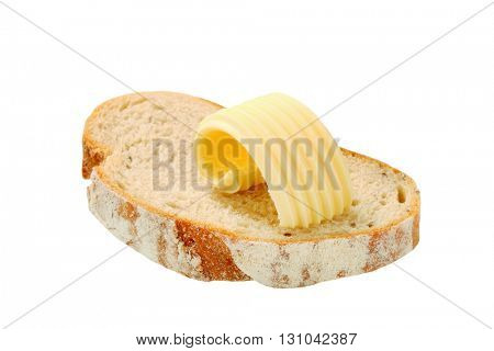butter curl on a slice of bread