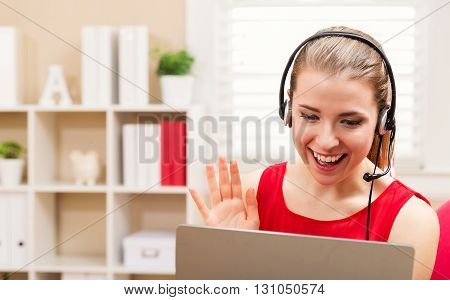 Happy Young Woman Talking On Her Laptop