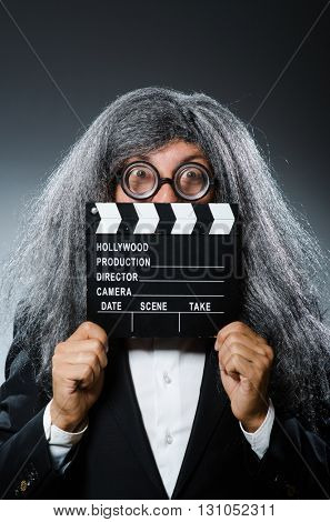 Funny man with movie clapboard