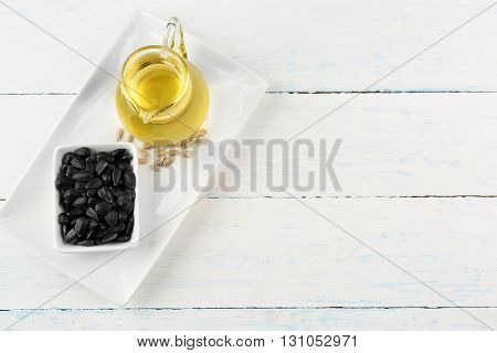 Sunflower seeds with oil on wooden table
