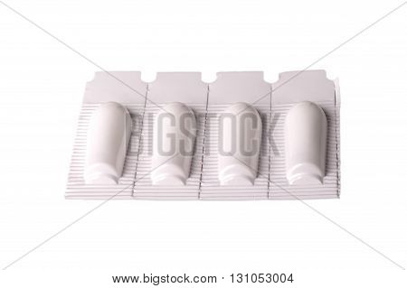 suppositories rectal cut on a white background