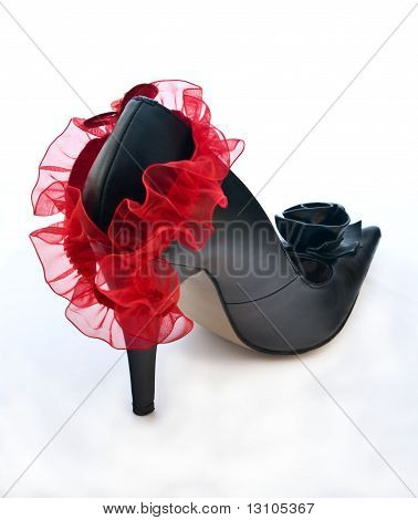 One Black Shoe With Red Garter For Stocking